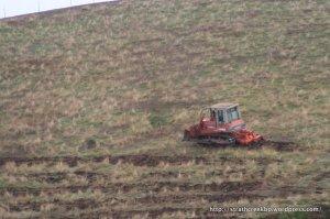 John Hamilton's dozer ripping the SW facing slope.